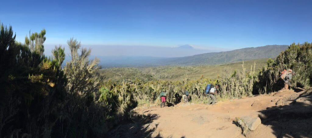 Two of our guides looking over me as I look back towards Machame Camp