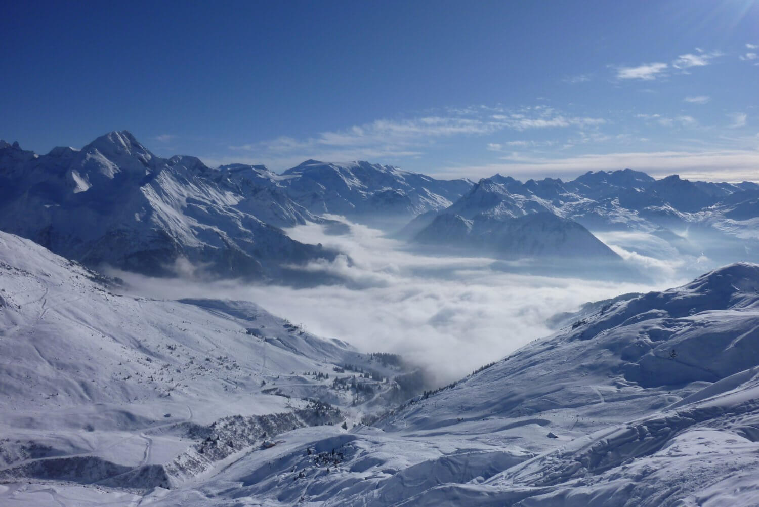 skiing above cloud tignes